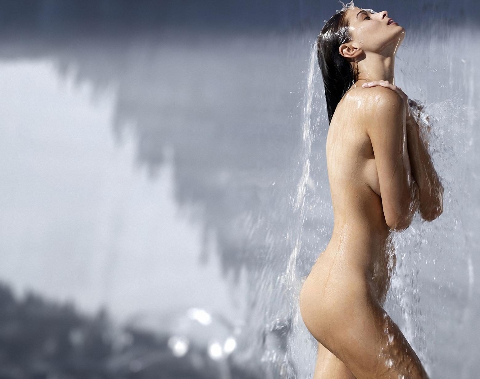 Wet bikini female enjoying outdoor tropical shower